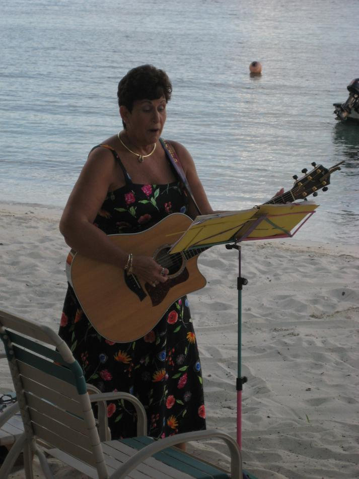 Diane singing at beach wedding