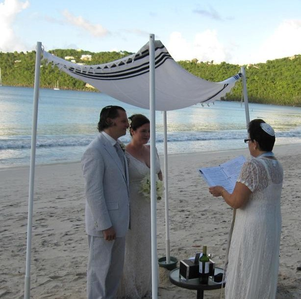 Kate and Josh on Magen's Bay Beach under portable Chuppah